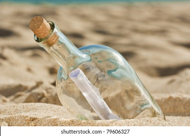 Lost message inside a bottle ashored at the beach and is waiting for someone to find it