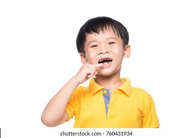 Lost milk tooth asian boy, Close up view.