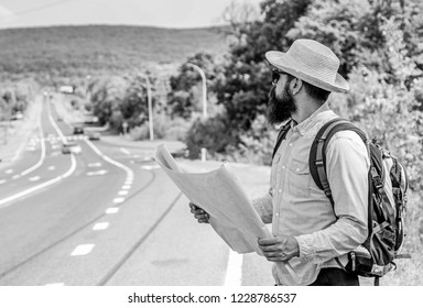 I am lost on my way. Tourist backpacker map lost direction travelling. Around the world. Find direction map large sheet of paper. Allow recognize enough details to walk somewhere if get lost.