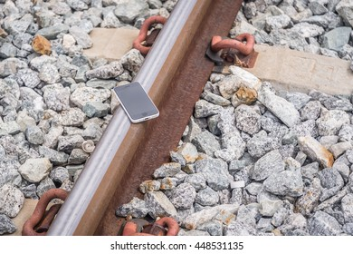 Lost Phone.The phone  dropped and fell to the railroad tracks .