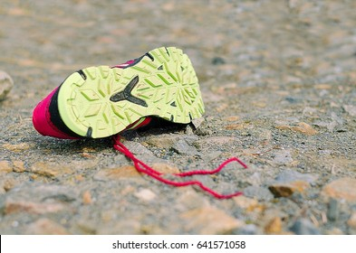 Lost running shoe. Tread of running shoe on rough sourface. Running concept.