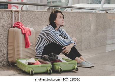 Lost woman caucasian traveller sitting on the floor in feeling bad because her lost in the city.