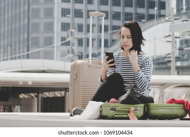 Lost woman caucasian traveller using mobile to ask directions in feeling bad because her lost in the city.