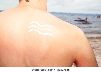 Lotion man with sunscreen sea waves on the sea background