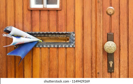lots of advertisement and letters from the postman in a door slot
