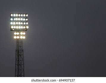 Lots of bright lights of a tower do during the sporting event
