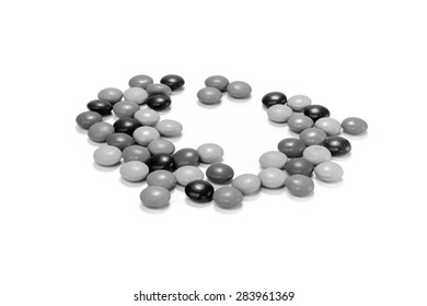 Lots of candies spread on white background, Black and white tone