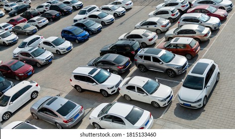 Lots of cars parking at outside carpark