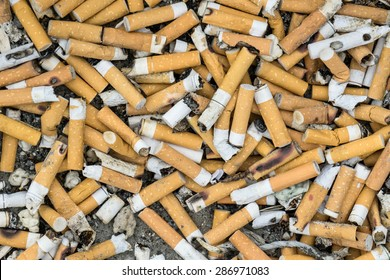 Lots of cigarette buds in a large ash tray