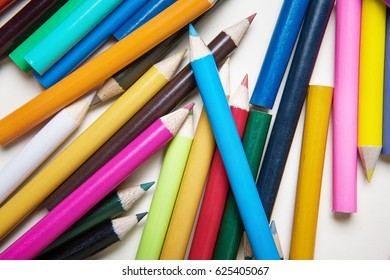 lots of colored pencils on white paper background image to add your own text if you want