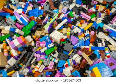 Lots of colorful Lego pieces. Lego background. Selective focus. Minsk, Belarus - March 2021