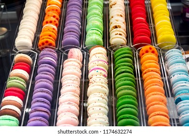 lots of colorful macaron in the pastry shop window in Paris