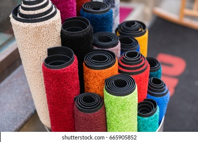 Lots of colorful rolled up carpets