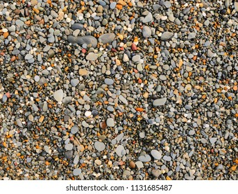 Lots of colorful small beach pebble stones close up