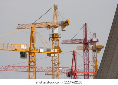 Lots of cranes at a construction site of a new power plant.