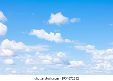 Lots of cumulus clouds far on horizon on blue daylight sky as natural background - Shutterstock ID 1934872832