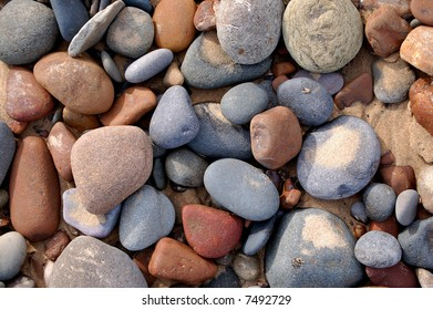 lots of different color pebbles on the beach