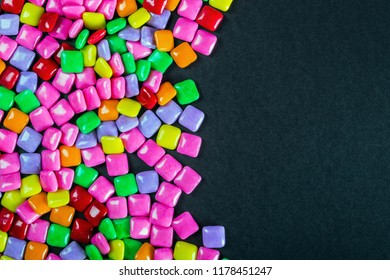 lots of different colors chewing gum on black background for your text
