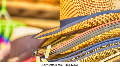 lots of fashion trendy hats in a market like souvenir