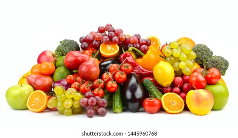 Lots of fresh and ripe berries, fruits, vegetables isolated on white background