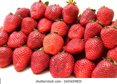 lots of fresh strawberries on a white background