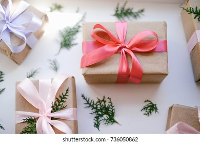 Lots of Gift boxes on wooden background. Presents in craft  paper decorated with  ribbon. Christmas and other holidays concept.