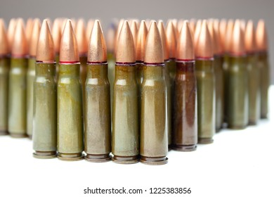 Lots of green and one brown 7.62 mm cartridges for Kalashnikov assault rifle
