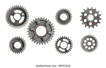 Lots of industrial metal gears isolated on a white background.