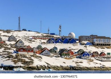 Lots of Inuit huts and colorful houses situated on the rocky coast along the fjord, Nuuk city, Greenland8