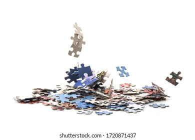 Lots of jigsaw piles combined And some are falling down, on white background.