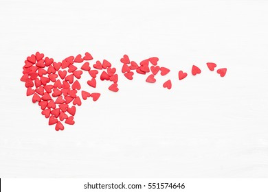 lots of little red hearts flying on white background. romantic love background for Valentine's day, birthday, holiday, party, wedding.