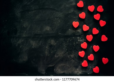 lots of little red hearts on black background. romantic love background for Valentine's day, birthday, holiday, party, wedding.