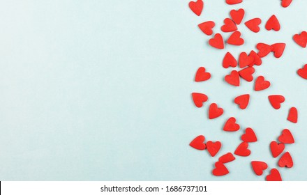lots of little red hearts on a blue background. pastel background for Valentine's day
