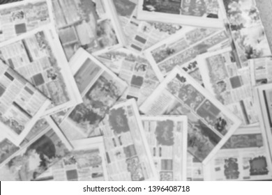 Lots of old newspapers on horizontal surface. Background texture, top view, blurred