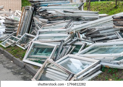 lots of old window frames uninstalled for replacement