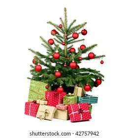 Lots of presents under the Christmas tree on white background
