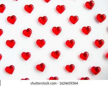 Lots of red hearts on a white background. The concept of Valentine's Day. Love.
