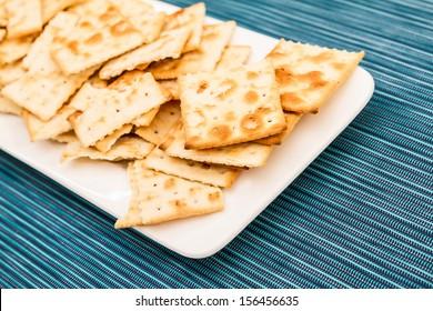 Lots of salted crackers, ones broken