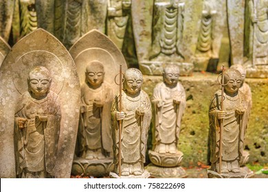 A lots of stone Jizo Bodhisattva statues background. Hase-dera in Kamakura, Japan. Hasedera is one of the largest Buddhist temples in the city within a pilgrimage circuit of the goddess Benzaiten.