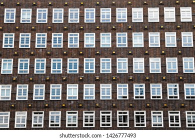 A lots of windows on the facade of a house in the inner city of hamburg in germany with brick wall