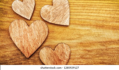 Lots of wooden hearts on the wooden table