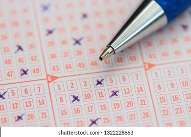 a lottery ticket with a pen