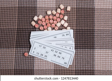 Lotto game. Wooden lotto barrels and card for a game in lotto. Board game lotto or bingo.
