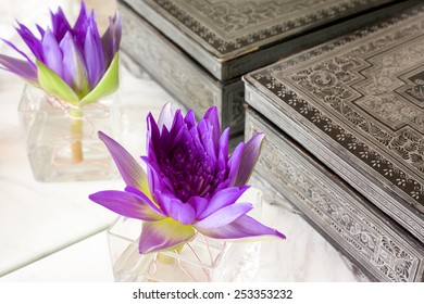 Lotus flower decoration with antique asian box in the mirror.