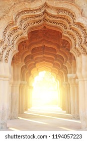 Lotus Mahal Temple in Hampi, Karnataka, India. Beautiful carved stone arch and sunset. A popular tourist route from the GOA state. Beautiful hindu temple.