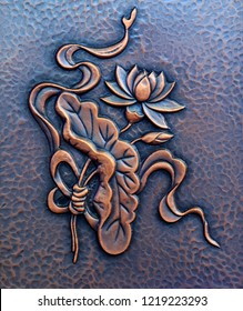 Lotus sculptures on metal panels