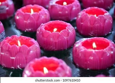 Lotus shaped wax candle offerings by devotees at Maha Vihara buddhish temple, Kuala Lumpur Malaysia, on wesak day.
