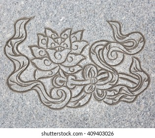 The Lotus sign, Tibetan one of eight  Auspicious Symbol engrave on stone texture