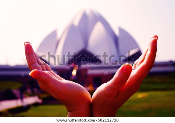 Lotus temple in the hand. New Delhi, India. Lotus temple - main temple for Baha'i religion.