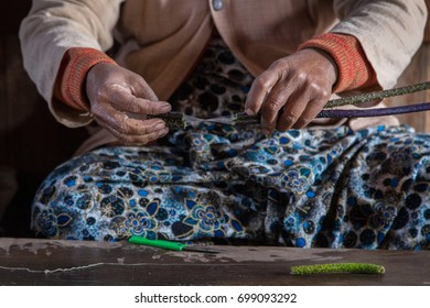 Lotus weaving at Inle lake, Myanmar. Woman extracts thin fiber thread from lotus stems. Lotus textiles are one of the most expensive fabrics in the world.